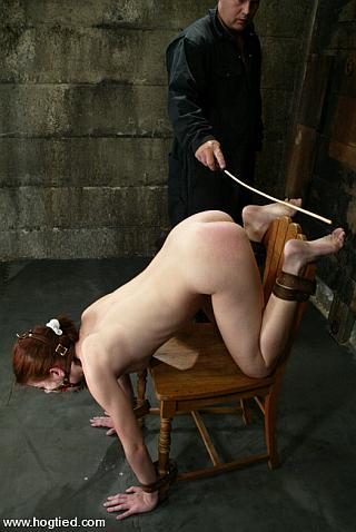 bondage girl at risk of a foot caning