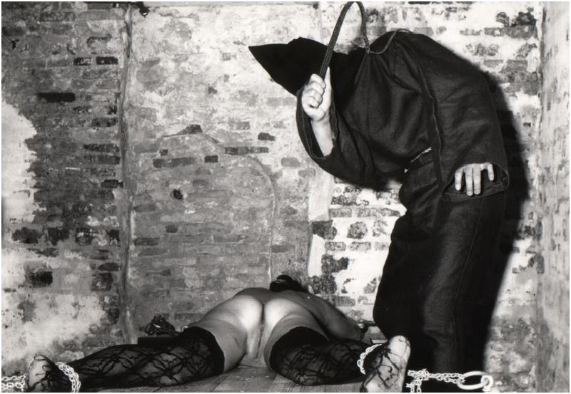 chained and whipped by hooded creep