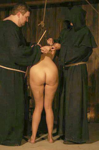 naked and bent over for a caning in the dungeons of the inquisition