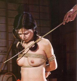 japanese girl being menaced with a cane