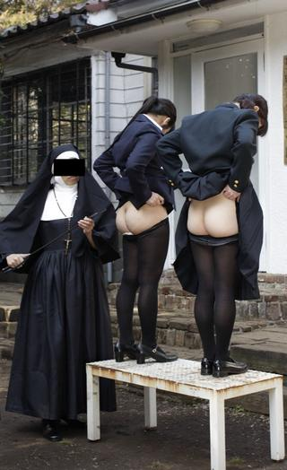brutal nun prepares to cane two catholic schoolgirls on the bare in Japan