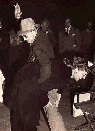 director john ford spanking movie star ann sheridan in public while she grabs his leg