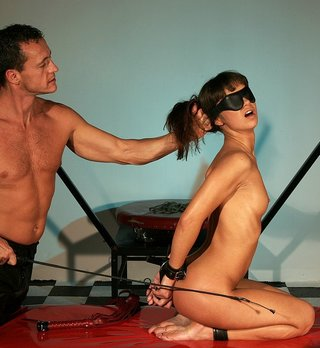 bondage girl menaced with a stock whip