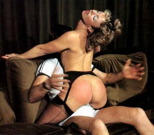 spanking her as she rides his lap