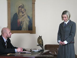 fearful and contrite schoolgirl presents herself in the headmaster\'s office for her punishment