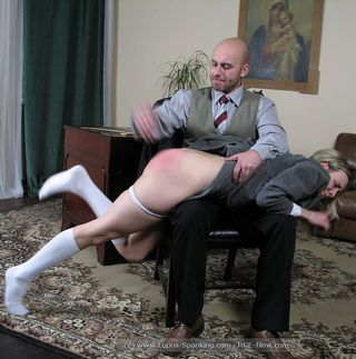 schoolgirl over headmaster\'s knee getting a vigorous OTK hand spanking