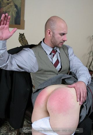 red bottomed schoolgirl well punished over the head masters knee