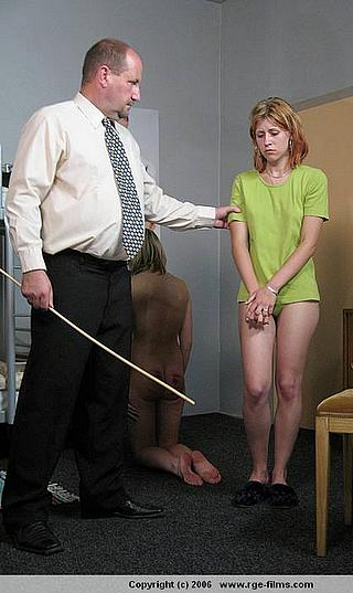 girl about to be caned and looking like she needs to pee