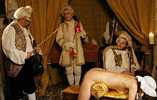 nobleman with tired arm from caning serving wenches