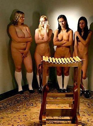 four girls trembling at the caning block