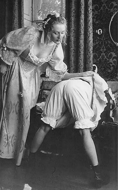 maid in bloomers, getting a caning