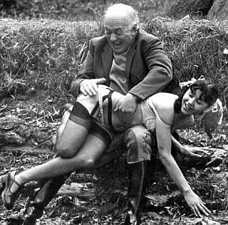 dirty old man gleefully spanking his happy maid