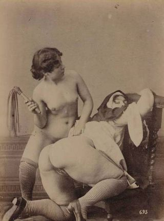 nun with a bare pussy getting whipped by a naked woman