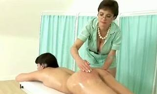 oiled bottom spanked on the massage table