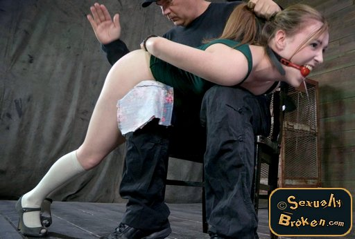 spanking the handcuffed girl over his lap