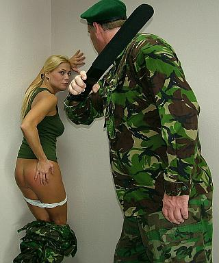 military girl getting the strap