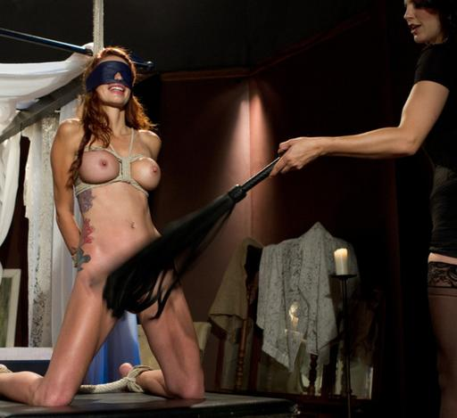 Monique Alexander kneeling up for a flogging