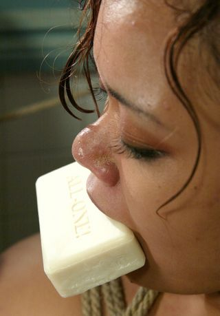 Annie Cruz suffering with a big bar of soap jammed in her mouth