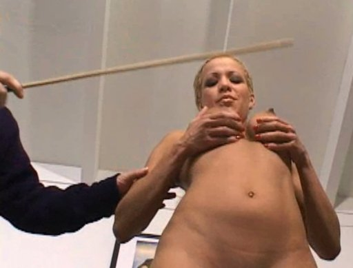 forced to hold out her nipples for cane strokes