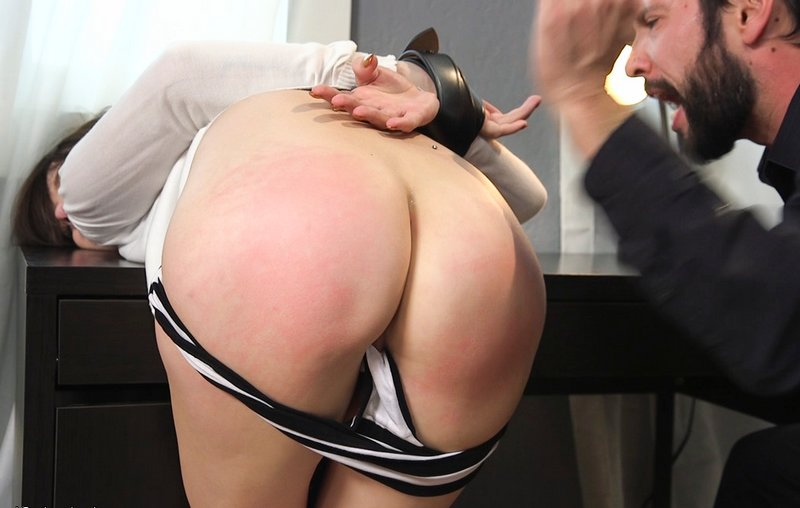spanked over his desk