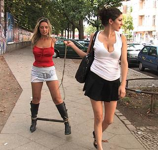 bondage girl being led to her public street spanking
