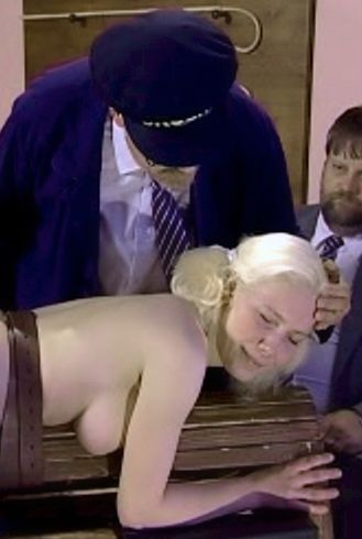 paddled blond girl in tears