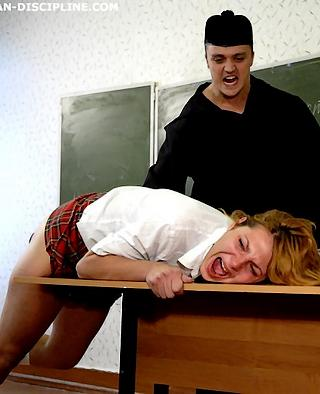 cracking the ass of a spoiled devushka with a hard wooden paddle