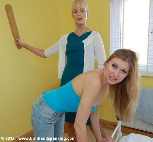 big wooden paddle is about to strike her ass