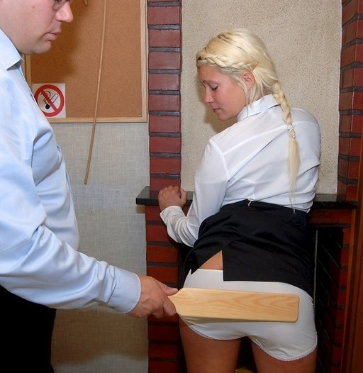Micaela gets a spanking with a thin pine paddle