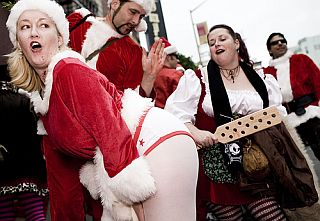 cute santa clause gets a paddle spanking