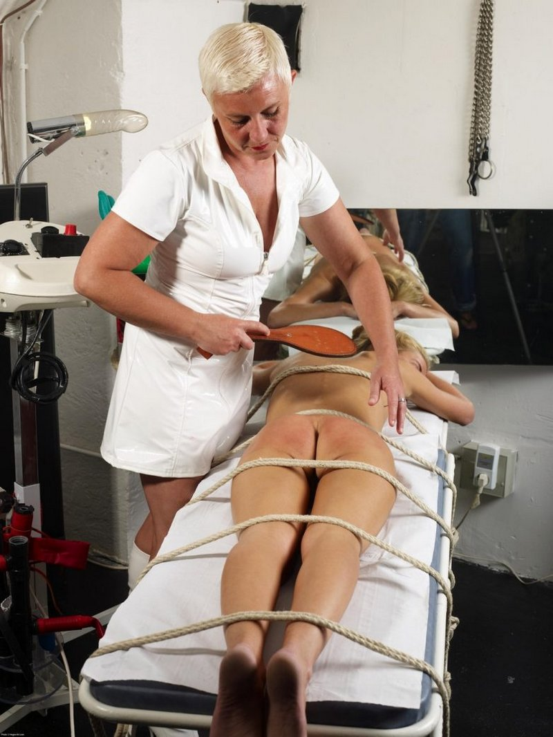 Thea tied down and spanked with a leather paddle