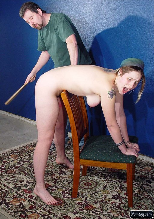 wendy from paintoy.com gets a hard wooden paddle spanking while bent over a kitchen chair