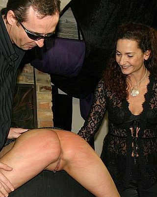 lady smiling at whipped slavegirl