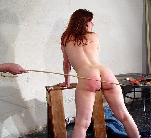 Pain Toy caning begins for girl whose bottom is already red from prior spanking and punishments