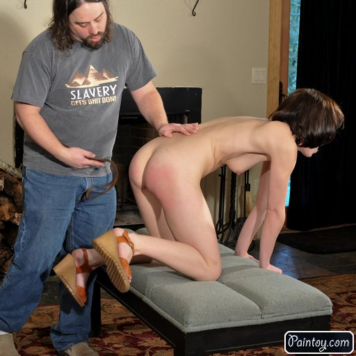 spanking his pain toy with a leather punishment strap