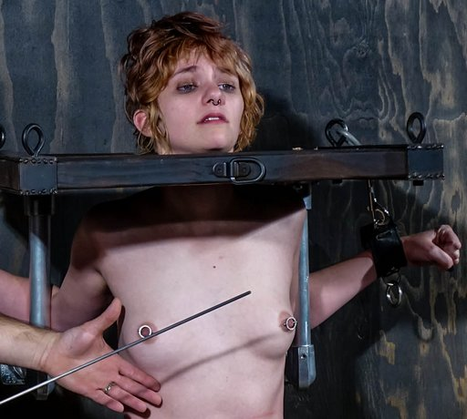 threatening her breasts with a metal cane