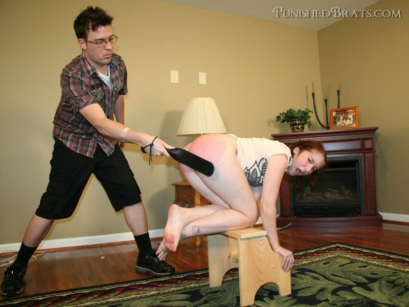 leather strap spanking for an unauthorized tattoo