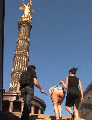 marched half-naked up the steps under the Victory Column for a public spanking
