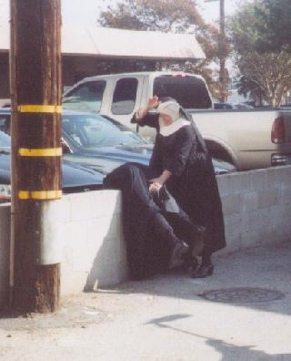 nun giving a spanking in a public parking lot