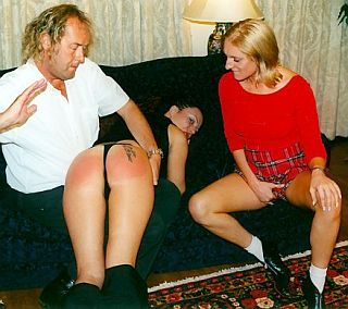 girl watching a spanking and masturbating