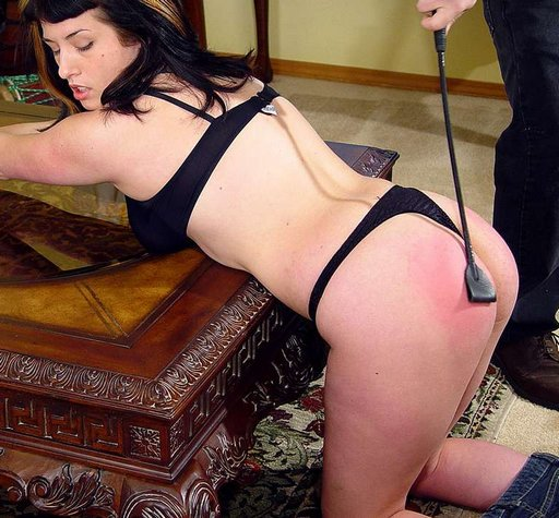 bottom spanked with riding crop until it is rosey red