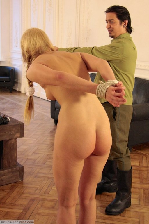 tied blonde girl being led to the whipping post