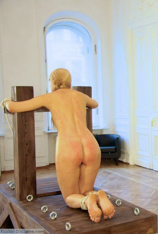 enduring a long punishment whipping for a cute blonde russian girl