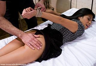 tied and spanked on the bed