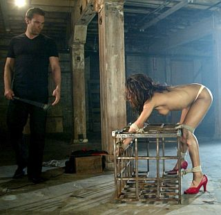 tied to a cage for a good spanking