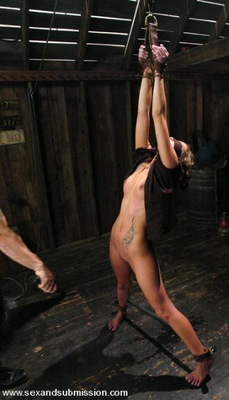 flogging her breasts
