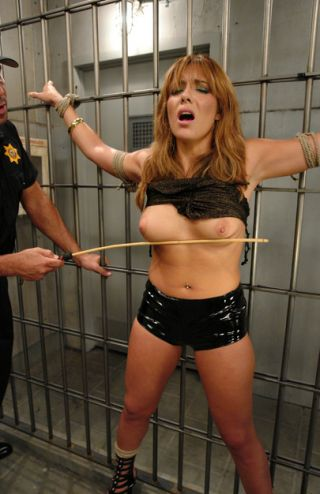 female prisoner threatened with breast caning