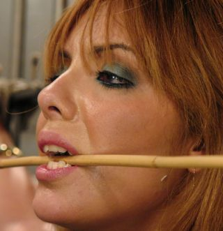lorena sanchez holds a cane between her teeth