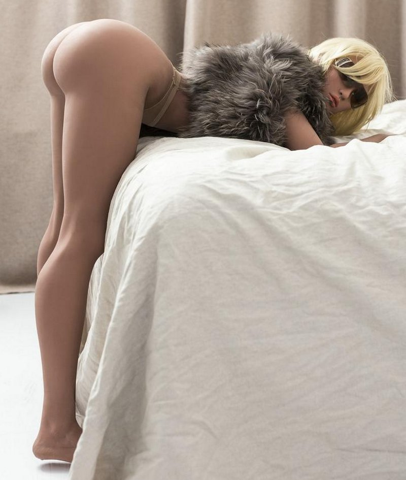 sex doll paris bent over as if for a caning