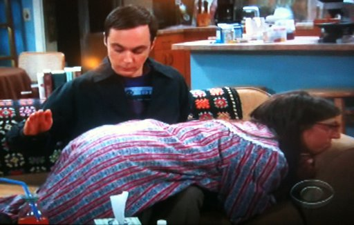 Sheldon spanking Amy for pretending to be sick on The Big Bang Theory